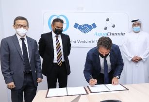 L R Subrato Saha V Anandkumar Directors of AquaChemie DMCC Lorenzo Carollo CEO of Kurita Middle East sign the joint venture agreement in the presence of Ahmad Sultan Al Haddad COO DP World